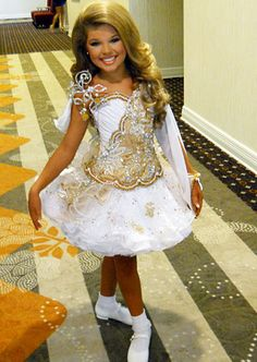 Toddlers and Tiaras. Never watched a single episode but this show horrifies me. Look at her! She looks nothing like a toddler!! O.O