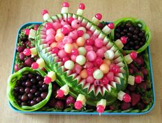 Fruit Centerpiece - I made this with Watermelon, Cantelope and Honeydew in the Watermelon Shell & a few Marachino Cherries. Little bowls lined with Kiwi Fruit are filled with grapes. The tray is line with Kiwi Fruit and filled in with strawberries.