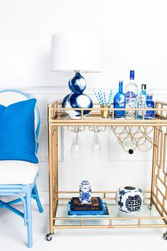 The Holloway Bar Cart, The Matisse Chair in French Blue, Porcelain Blue Pillow, Blue and White Tea Jar - Society Social