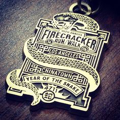 February 12, 2012.  Los Angeles Chinatown Firecracker 5K.  (Pictured is the 2013 medal.  I earned the 2012 medal.)  http://firecracker10k.org/