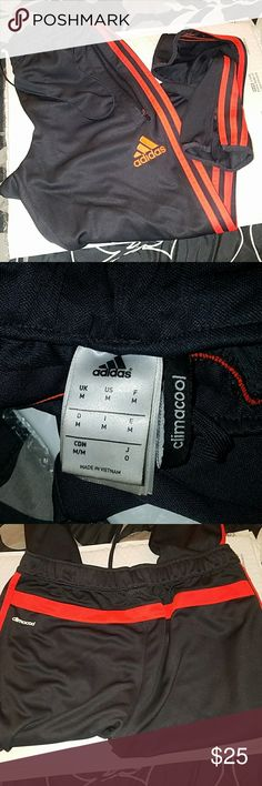 Adidas climacoal slate grey joggers Adjustable slate grey joggers with the red/orange classic Adidas stripes! Super comfy adjustable zippered ankle goes from skinny to flare (as seen in pics) with mesh back waistband. Could be worn unisex but will fit upto size 10 womens. Adidas Pants Track Pants & Joggers