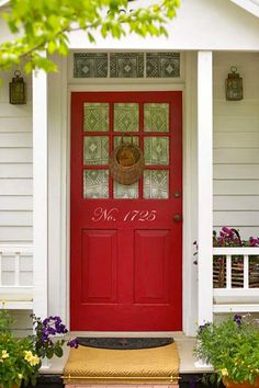 Adorn your door with house numbers in an oversize fancy font so that friends can find you easily. Stick-on vinyl decals in a range of fonts and colors make it simple. | Photo: Courtesy of Etsy