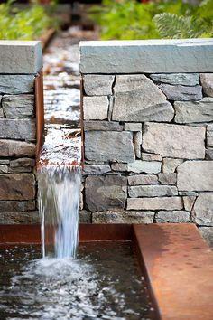 Corten rill cutting through drystone wall. We like!