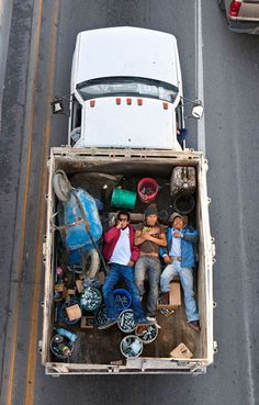 Alejandro Cartagena   Carpoolers    http://www.flavorwire.com/294652/poignant-photos-of-sleeping-carpoolers-captured-from-above?all=1#