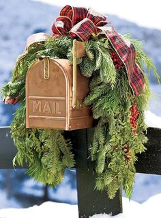 tartan plaid bow on live greens covering mailbox