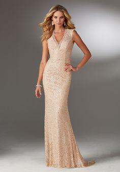 Evening Dresses and Mother of the Bride Dresses by Morilee by Madeline Gardner. Form Fitting Stretch Lace Evening Gown with V Neckline and All Over Beading.