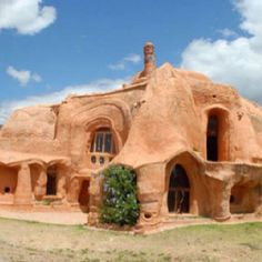 a dirt house--wow impressive with a kind of massive earthy power to it.  It would be very empowering, pagan affirming experience, I think, to live in a house like this!