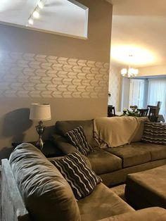 A DIY Stenciled Living Room Accent Wall In Neutral Hues Using The Drifting Arrows Allover Stencil