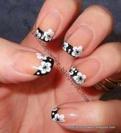 Did black tips w/a white line an one black finger nail w/white flowers