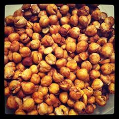 ~ ROASTED CHICK PEAS ~ 1. Rinse the chickpeas and pat dry with a paper towel. Place on cookie sheet.  2. Mist with olive oil and desired spices. Cayenne Pepper, Paprika, Garlic Powder, etc.  3. Put the pan in the oven BEFORE you turn it on.  4. Turn the oven on to 425 degrees and roast them for 45 minutes, stirring every 10 min.  5. Shut the oven off and leave them in there for about an hour and a half and DONE.