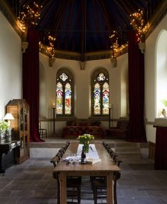 The grand dining room is located in the nave of the church. The new owners restored key elements, like the vaulted ceilings and original stained glass windows, and they invested time and money to maintain its exterior and interior while readapting the interior to give it a homelike atmosphere.