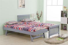 This grey single bed frame includes a standard bed and a trundle bed. The trundle bed can be pulled out and raised to the same height as the main bed, when not in use it can be folded away under the main bed to save space. It's ideal for small sized rooms, such as guest rooms, kid's bedroom and so on.