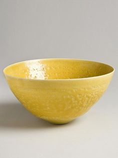 Yellow Bowl by Lucie Rie, shown by Joanna Bird. Circa 1940, engraved sgraffito style bands under yellow pitted glaze.