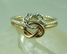 14k Solid Gold and Sterling Silver Love Knot by fallingleafjewelry