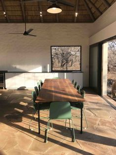 The winter afternoon sun baking the slasto floors of this Marcus Smit Architects designed home allows for passive heat radiating from the floor after sunset Architect Design, Architects, Floors, Dining Table, House Design, Windows, Sunset, Baking, Winter