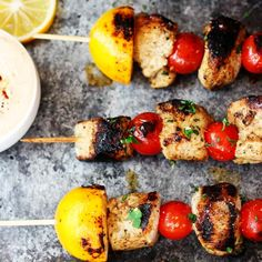 Say bye to boring grilling! These Lemon Chicken Skewers cook up perfectly on the grill and are served with a side of Harissa Yogurt sauce. Grilled Lemon Chicken, Yogurt Chicken, Healthy Cooking, Healthy Eating, Summer Grilling Recipes, Southern Dishes, Yogurt Sauce, Chicken Skewers, Family Meals