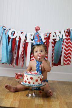 Dr. Seuss 1st birthday pictures with smash cake. Outfit from etsy.