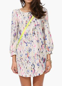 Love graphic prints--I also like this dress style. Show off the legs but keep it classy by covering up the top half.
