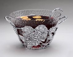 Arthur Court Logo Grape Punch Bowl $275.00 Suggested retail  Product ID:103482 Features:Holds about 6 1/4 quarts. Ladle sold separately, see item 10-3568.  WISH LIST