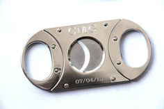 Personalized Cigar Cutter, Groomsmen Gift, Custom Cigar Cutter, Guillotine Cutter, Golf Gift, Gift for Men, Fathers Day Gift, Engraved Groomsman Gift  Very nice personalized cigar cutter. Celebrate any event by personalizing with initials and a special date. These make perfect gifts for any cigar lover. Each comes in its own gift box.  Available in two colors:  Silver Two Toned(Gun metal handles and Silver Body)   Processing and Delivery Times:  Our Standard Processing Time is 5 Business…