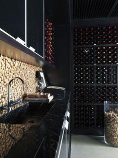 Cork backsplash in wine cellar; António Ferreira Junior