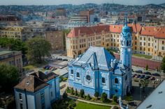 Bratislava Blue Church - horizontal tilt-shift with the church fully sharp by erasing the tilt shift over the church's spire Cheap City Breaks, Bratislava, Getting Out Of Bed, Make Your Bed, Go Outside, Our Life, Hungary, Budapest, Wake Up