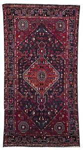 ORIENTAL RUG: HAMADAN Red geometric medallion and pendants at center ... Lot 154