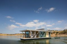 """There's off-grid and then there's so off-grid that you can float around for months without so much as stepping on dry land. This sleek tiny home , dubbed the Floatwing, is designed to be entirely self-sufficient on the water, generating its own power for anywhere between four and six months, and up to 80 percent of its annual energy needs. Described as a """"mobile house in the middle of a lake"""" by its inventors, Portugal-based company Friday , the floating home's two outboard motors propel it…"""