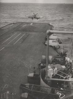 Corsair fighter taking off from the flight deck of armoured aircraft carrier HMS Illustrious, off Japan, 1945.