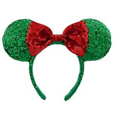 Disney Holiday Minnie Mouse Ear Headband with Bow | Disney StoreHoliday Minnie Mouse Ear Headband with Bow - Make your merry season even sweeter with Mickey's sweetie and her sequined holiday headband. Minnie's trademark ears and bow have turned green and red with a touch of holly for a festive fashion topper.