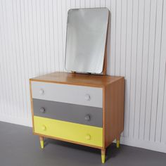 Foster - £270.00 - Boldly painted drawers enhance the retro feel of this mid-century dresser and the dip painted feet add a pop of colour. Xylo.