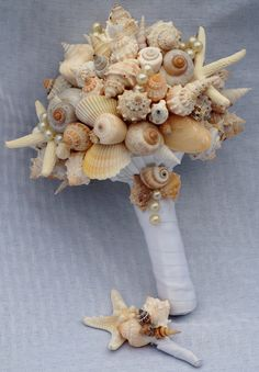 Starfish, Pearl, and Seashell Bouquet w Boutonniere Set. $118.00, via Etsy.