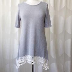Super Cute BOHO Crocheted Pom Pom Fringe DRESS Super cute dress!! Can also be worn as a tunic. Gray with crocheted/knitted detail trimming.  Super soft! 95% poly, 5% rayon.  Semi sheer. Size small.  True to size. Young contemporary fit. Great alone or with skinny jeans/leggings! This is perfect for spring and summer! Made in USA!! Ask any questions please!NEW RETAIL with tags. Thanks for viewing my closet Boutique Dresses Mini