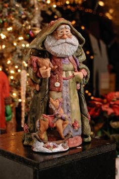 Santa figurines by Dennis Brown Artist