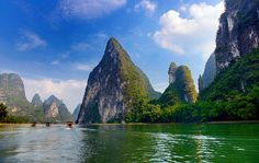 Limpid with crystal water,take a bamboo raft to  travel into the painting of liRiver,Guilin,China