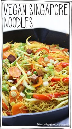Vegan Singapore Noodles! Slightly spicy, jam-packed full of curry deliciousness, tossed with medley of veggies, and chewy tofu bites. This is a great recipe for cleaning out the fridge. So quick and easy! #itdoesnttastelikechicken