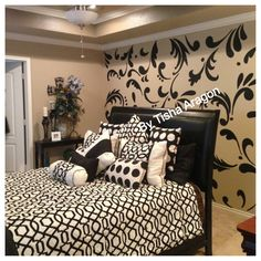 Painted damask wall in bedroom