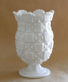 Love This Milk Glass Piece.  I have one from my Grandmother just like it!  Great for flowers!