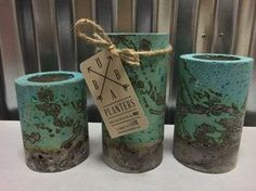 These concrete planters are designed for succulents or air plants. Each one is hand made and hand stained. Includes set of (3) planters. One of each (4, 5,6 tall). 3 diameter. Cavity is 2 wide x 2 deep.  Succulents not included.  Dominant colors are light blue, greens, shades of browns and grays.  Ships within 1-3 biz days USPS. But I usually get them out within hours of purchase. Please message me for all Wholesale inquiries.  Thanks for stopping by, Hope you find what youre looking for