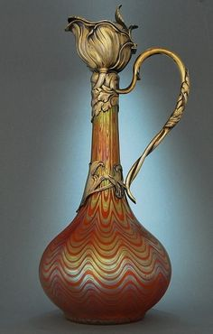 Loetz Claret jug - Art Nouveau about I adore the windblown flower spout. How can a heavy, immovable substance like bronze be made to look so light and blowy? Antique Glass, Antique Art, Vintage Antiques, Belle Epoque, Jugendstil Design, Glas Art, Art Nouveau Design, Oeuvre D'art, New Art