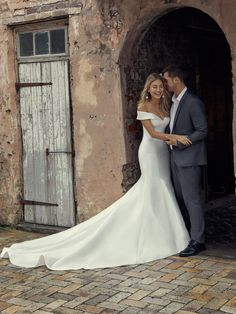 Rebecca Ingram Josie - Huron Mikado creates this exquisite fit-and-flare wedding dress featuring a sweetheart neckline with off-the-shoulder sleeves and covered buttons trailing down the train.