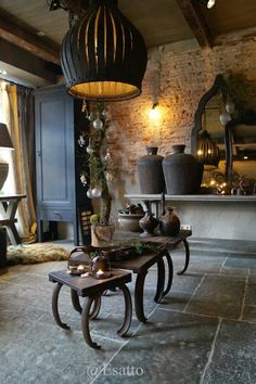 Elegant living room using black objects and brick walls...!