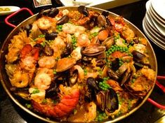 The Ultimate Paella Party - looks good for Christmas Eve!! Fish Dishes, Seafood Dishes, Fish And Seafood, Seafood Recipes, Cooking Recipes, Seafood Paella Recipe, Spanish Paella Recipe, Recipes Dinner, Healthy Recipes