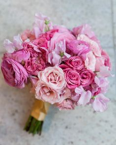 For this bride's all-pink bouquet, event planner and designer Gretchen Culver of Rocket Science Events assembled garden roses, standard roses, spray roses, ranunculus, and sweet peas.