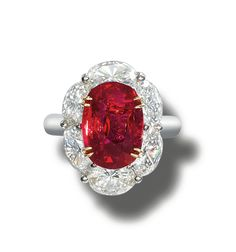 FINE RUBY AND DIAMOND RING.  The oval ruby weighing 5.04 carats, bordered by similarly cut diamonds, mounted in white and yellow gold,