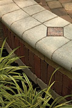 Unilock - Wall and Pillar with BrusselsBlock and Fullnose paver using Copthorne