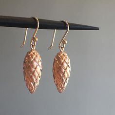 Rose gold pinecones by Ted Muehling