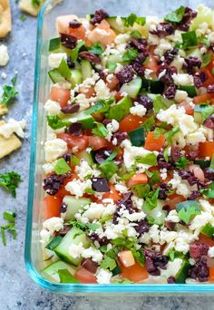 Healthy Greek Layer Dip. A fun twist on classic Mexican 7 layer dip with Greek ingredients!