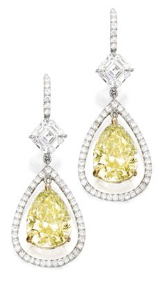Platinum, 18 Karat Gold, Fancy Yellow Diamond and Diamond Earrings. Set with two pear-shaped Fancy Yellow diamonds weighing 3.92 and 3.45 carats, suspended from two square emerald-cut diamonds weighing 1.05 and 1.02 carats, further accented by small round diamonds weighing approximately .70 carat. Sotheby | La Beℓℓe ℳystère