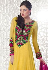 Dreamy variation on shape and forms compliment your style with tradition. The dazzling yellow faux georgette churidar suit have amazing embroidery patch work is done with resham, sequins, stone and lace work. Beautiful embroidery work on kameez is stunning. The entire ensemble makes an excellent wear. Matching santoon churidar and double dye chiffon dupatta is available with this suit. Slight Color variations are possible due to differing screen and photograph resolutions.
